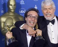 James Coburn and Roberto Benigni at the Annual Academy Awards.