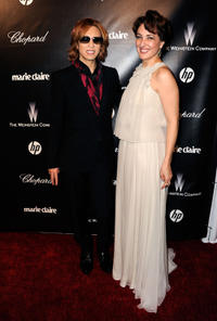 Musician Yoshiki and Meltem Cumbul at the 69th Annual Golden Globe Awards in California.