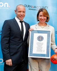 Hugh Dillon and chief marketing officer for ION Media Networks at ION Television Eleo Hensleigh at the world record break attempt of ION Media for the Largest Moving Box in New York.