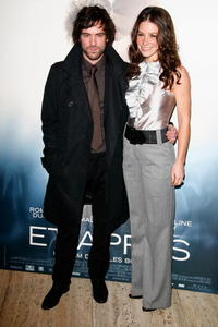 Romain Duris and Evangeline Lilly at the Paris premiere of