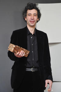Eric Elmosnino at the photocall of Cesar Film Awards 2011 in France.