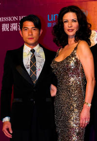 Aaron Kwok and Catherine Zeta-Jones at the red carpet during day three of the Mission Hills Start Trophy tournament in China.