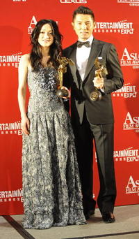 Zhou Xun and Masahiro Motoki at the Third Asian Film Awards Ceremony.