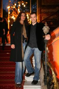 Bruno Putzulu and Guest at the opening of the new Mulberry flagship store.