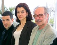 """Bruno Putzulu, Cecile Camp and Jean-Luc Godard at the photocall of """"L'Eloge de l'Amour"""" during the 54th Cannes Film Festival."""