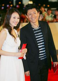 Yuan Quan and Xia Yu at the awards ceremony of 25th China Golden Rooster Awards.