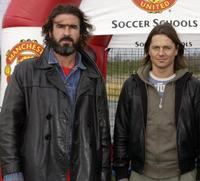 Eric Cantona and Daniel Bravo at the soccer schools entrance at Disneyland resort.