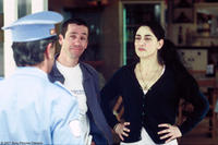 Sasson Gabai as Tewfiq, Ronit Elkabetz as Dina and Rubi Moscovitz as Itzik in