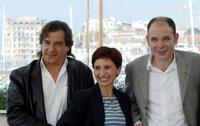Gerard Meylan, Ariane Ascaride and Jean-Pierre Darroussin at the photocall of