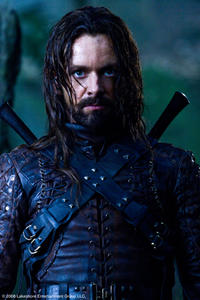 Michael Sheen as Lucian in