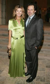 Dennis Miller and Guest at the Gucci Spring 2006 Fashion Show Benefitting The Children's Action Network.