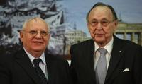 Mikhail Gorbachev and Hans-Dietrich Genscher at the Urania Theater in Berlin.