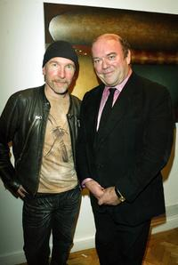 The Edge and Paul McGuinness at the opening of the new collection by artist Guggi.