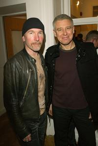 The Edge and Adam Clayton at the opening of the new collection by artist Guggi.