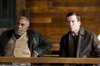 Bill Cobbs as Rev. Jackson and Lucas Black as Buddy in