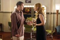 Adam Sandler as George and Leslie Mann as Laura in