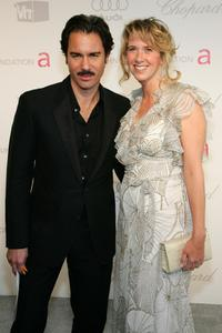 Eric McCormack and Janet Holden at the 15th Annual Elton John AIDS Foundation Academy Awards viewing party.