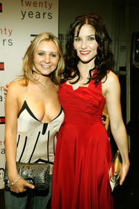 Beverley Mitchell and Sophia Bush at the Tommy Hilfiger Spring 2006 fashion show during the Olympus Fashion Week in New York.