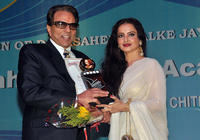 Dharmendra and Rekha at the Dadasaheb Phalke Awards 2011 in Mumbai.