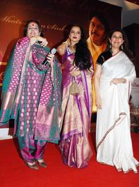 Poonam Sinha, Rekha and Kamia Malhotra at the party honoring Shatrughan Sinha's election to the national parliament.