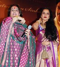 Poonam Sinha and Rekha at the party honoring Shatrughan Sinha's election to the national parliament.