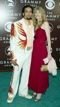 Ben Harper and Laura Dern at the 47th Annual Grammy Awards.