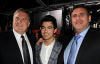 Producer Tim Headington, musician Joe Jonas and Graham King at the premiere of