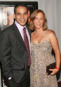 John Ortiz and guest at the premiere of
