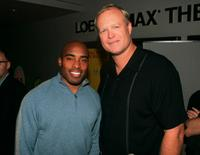 Tiki Barber and Bill Fagerbakke at the premiere of