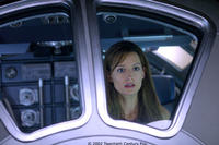 Rheya (Natascha McElhone) cannot comprehend her own sudden appearance on a space station orbiting a mysterious planet.