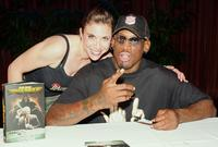 Wendy Aaron and Dennis Rodman at the signing of
