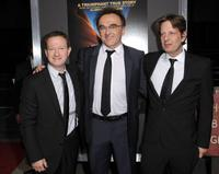 Simon Beaufoy, writer/director/producer Danny Boyle and producer Christian Colson at the premiere of