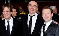 Producer Christian Colson, director Danny Boyle and Simon Beaufoy at the 81st Annual Academy Awards.