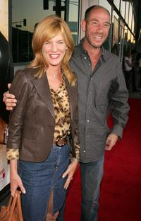 Miguel Ferrer and guest at the premiere of