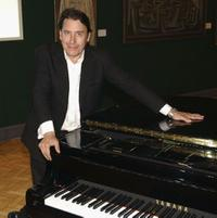 Jools Holland at the Auction of his Piano at Bonham's Autumn Fine Piano Sale.