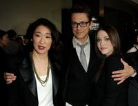 Sandra Oh, Peter Stebbings and Kat Dennings at the premiere of