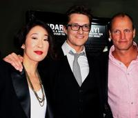 Sandra Oh, Peter Stebbings and Woody Harrelson at the premiere of