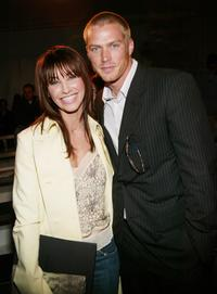 Gina Gershon and Jason Lewis at the Calvin Klein Fall 2004 Fashion show during the Olympus Fashion week.