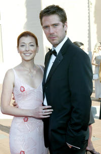 Alyson Hannigan and Alexis Denisof at the 2002 Creative Arts Emmy Awards in California.