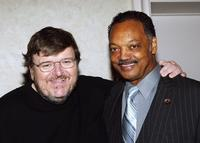 Michael Moore and Jesse Jackson at the Seventh Annual Awards Dinner 63rd birthday celebration.