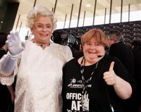 Magda Szubanski and Guest at the L'Oreal Paris 2006 AFI Awards.