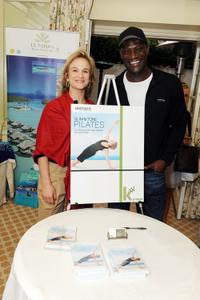 Peter Mensah and Guest at the DPA Golden Globes Gift Suite.