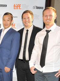 Director Shawn Ku, David Lipper and Guest at the premiere of