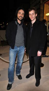 Vincent Martinez and Malik Zidi at the opening of a New YSL store.