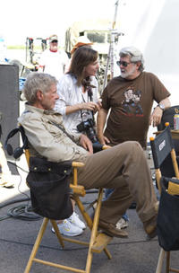 Harrison Ford and executive producers Kathleen Kennedy and George Lucas on the set of