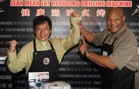 Jackie Chan and George Foreman at the promotional event for Foreman's grill in Hong Kong.