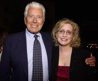 John Forsythe and date at the premiere of