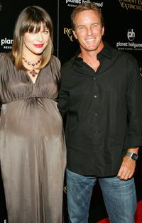 Milla Jovovich and Linden Ashby at the premiere of