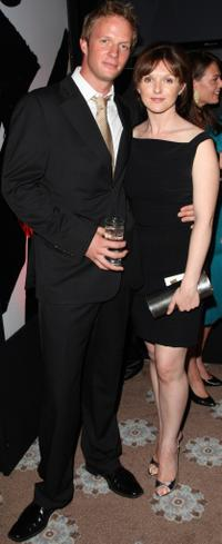 Rupert Penry-Jones and his wife at the Kuro Black Screen party.
