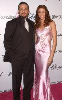 Joseph D. Reitman and Shannon Elizabeth at the 13th Annual Elton John Aids Foundation Academy Awards viewing party.